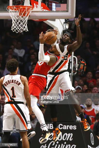 Carmelo Anthony of the Portland Trail Blazers is fouled by Montrezl Harrell of the Los Angeles Clippers during the first half at Staples Center on...