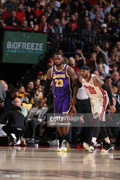 Carmelo Anthony of the Portland Trail Blazers plays defense on LeBron James of the Los Angeles Lakers on December 6, 2019 at the Moda Center Arena in...