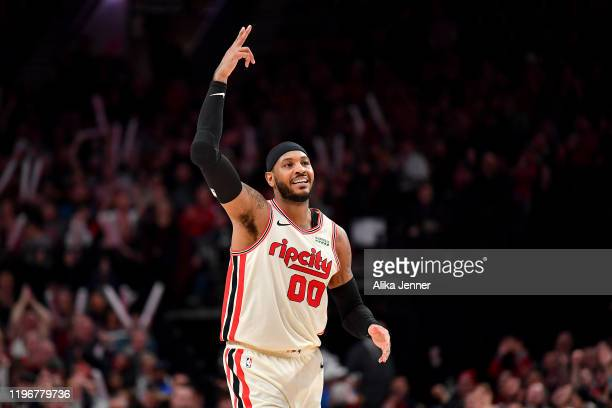 Carmelo Anthony of the Portland Trail Blazers reacts to a play during the second half of the game against the Phoenix Suns at the Moda Center on...