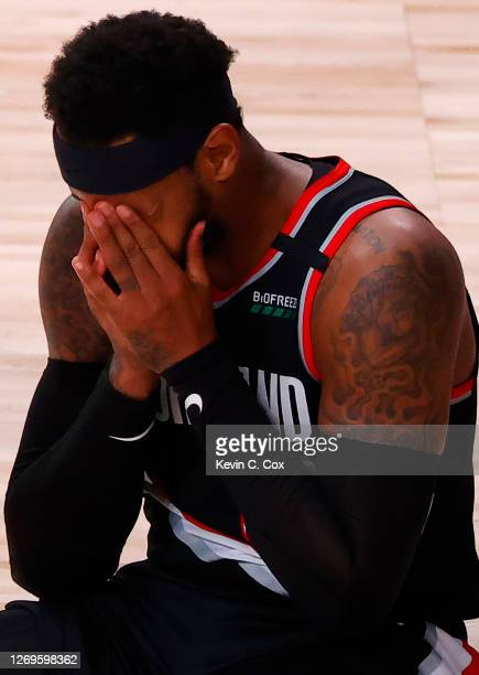 Carmelo Anthony of the Portland Trail Blazers reacts to having the ball stripped away by Danny Green of the Los Angeles Lakers and giving up a basket...