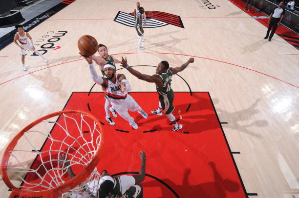 Carmelo Anthony of the Portland Trail Blazers shoots the ball during the game against the Milwaukee Bucks on April 2 2021 at the Moda Center Arena in...