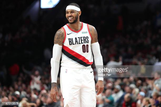 Carmelo Anthony of the Portland Trail Blazers smiles in the fourth quarter against the Sacramento Kings during their game at Moda Center on December...