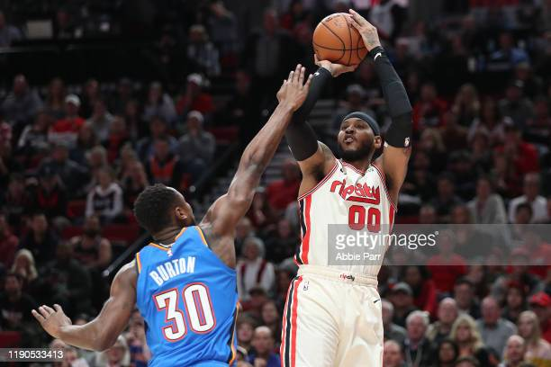 Carmelo Anthony of the Portland Trail Blazers takes a shot against Deonte Burton of the Oklahoma City Thunder in the first quarter during their game...