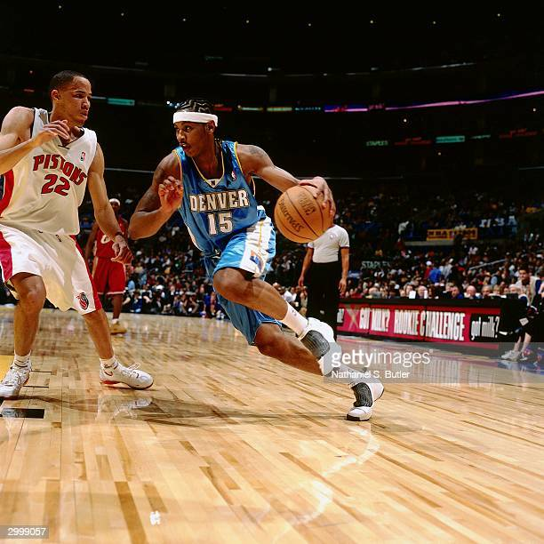 Carmelo Anthony of the Rookie Team drives against Tayshaun Prince of the Sophomore Team during the got milk Rookie Game on February 13 2004 at...