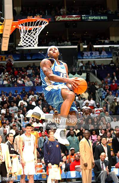 Carmelo Anthony of the Rookie Team slam dunks during the Got Milk Rookie Challenge part of the 53rd NBA AllStar weekend at Staples Center on February...