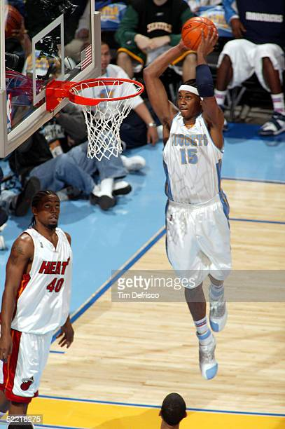 Carmelo Anthony of the Sophomore Team goes for a dunk against the Rookie Team in the got milk Rookie Challenge during 2005 NBA AllStar Weekend at the...