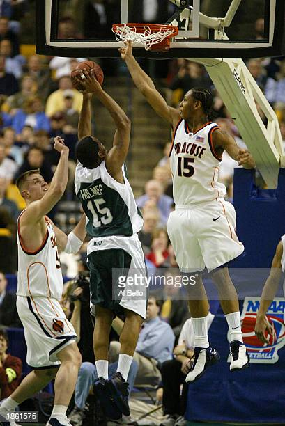 Carmelo Anthony of the Syracuse Orangemen attempts to block the shot of Dave Holmes of the Manhattan Jaspers during the first round of the NCAA...