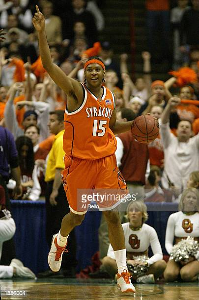 Carmelo Anthony of the Syracuse Orangemen celebrates his team's 63-47 win over the Oklahoma Sooners during the East Regionals of the NCAA...