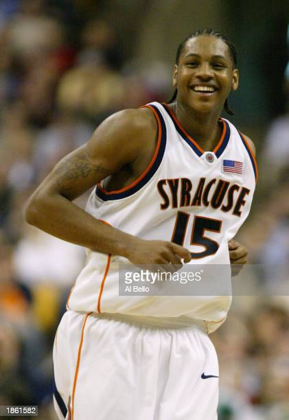 Carmelo Anthony of the Syracuse Orangemen celebrates their 7665 win over the Manhattan Jaspers during the first round of the NCAA Championship on...