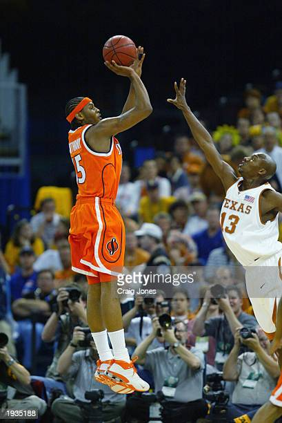 Carmelo Anthony of the Syracuse University Orangeman shoots over Sydmill Harris of the University of Texas at Austin Longhorns during the semifinal...