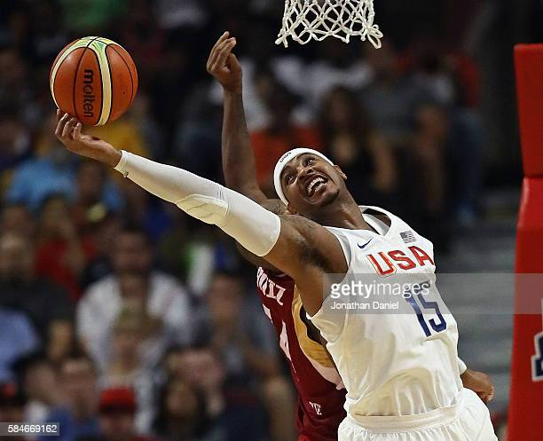 Carmelo Anthony of the United States grabs a rebound over Miguel Ruiz of Venezuela during preOlympic exhibition game at United Center on July 29 2016...