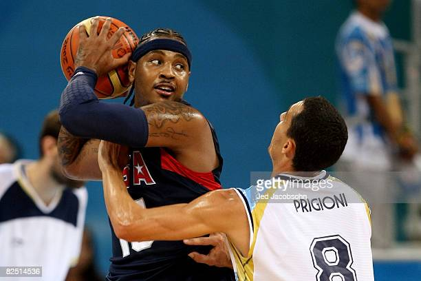 Carmelo Anthony of the United States is guarded by Pablo Prigioni of Argentina during a men's semifinal baketball game at the Wukesong Indoor Stadium...
