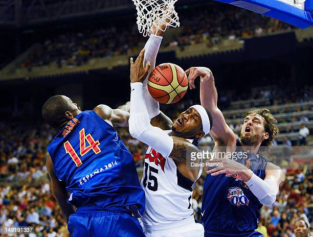 Carmelo Anthony of the US Men's Senior National Team duels for the ball with Pau Gasol and Serge Ibaka of the Spain Men's Senior National Team during...