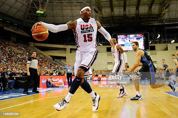 Carmelo Anthony of the US Men's Senior National Team runs the ball during a PreOlympic Men's Exhibition Game between USA and Argentina at Palau Sant...