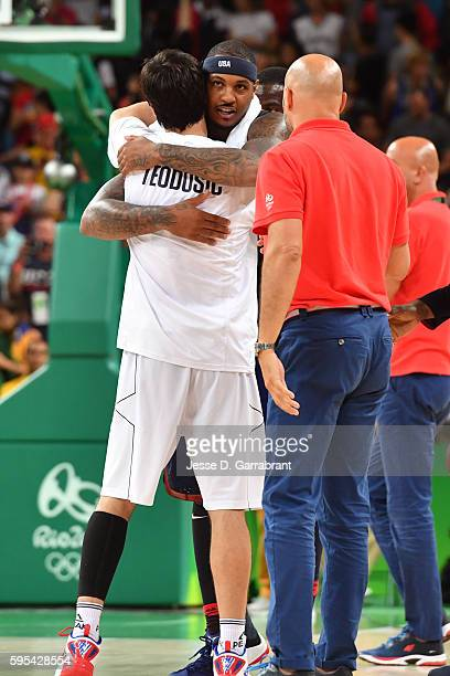 Carmelo Anthony of the USA Basketball Men's National Team hugs Milos Teodosic of Serbia after the game during the Gold Medal Game on Day 16 of the...