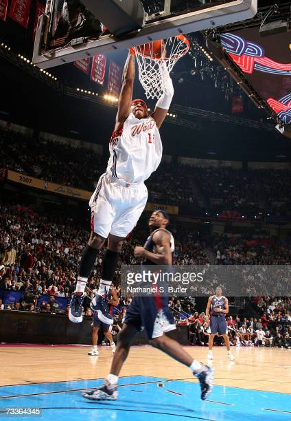 Carmelo Anthony of the Western Conference dunks against LeBron James of the Eastern Conference during the 2007 NBA All-Star Game on February 18, 2007...