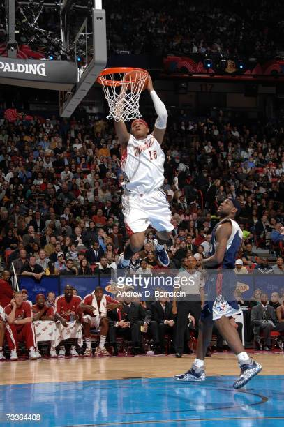 Carmelo Anthony of the Western Conference goes up for a dunk as LeBron James of the Eastern Conference looks on in the first half of the 2007 NBA...