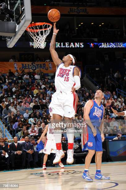 Carmelo Anthony of the Western Conference shoots a layup as Jason Kidd of the Eastern Conference looks on during the 2008 NBA AllStar Game part of...