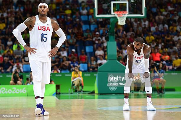 Carmelo Anthony of United States and teammate Kyrie Irving look on during a Men's Preliminary Round Group A game between the United States and France...
