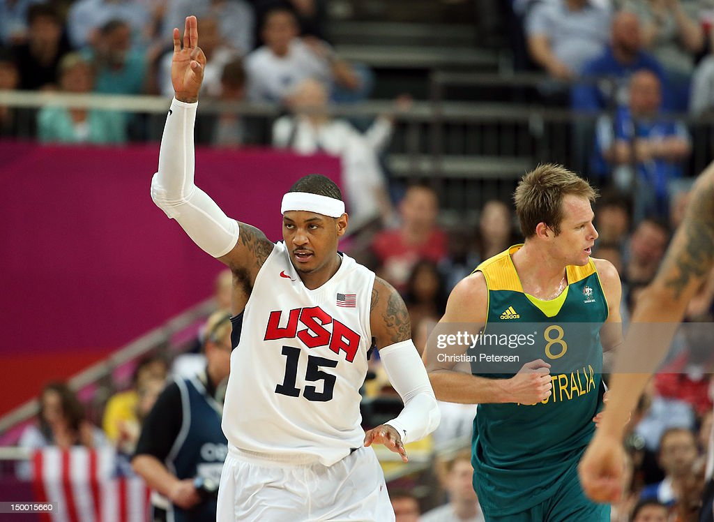 Carmelo Anthony #15 of United States reacts after making a three-pointer alongisde Brad Newley #8 of Australia in the third quarter during the Men's Basketball quaterfinal game on Day 12 of the London 2012 Olympic Games at North Greenwich Arena on August 8, 2012 in London, England.