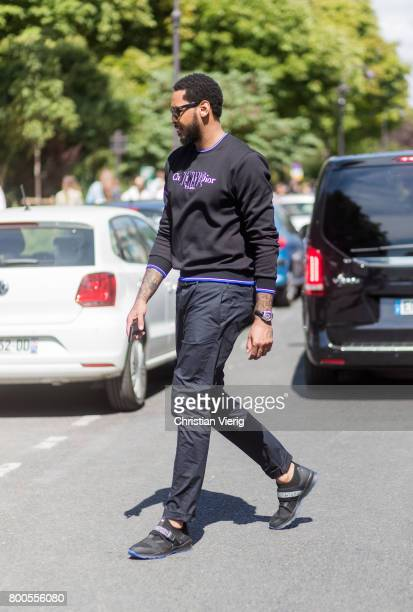 Carmelo Anthony outside Dior Homme during Paris Fashion Week Menswear Spring/Summer 2018 Day Four on June 24 2017 in Paris France