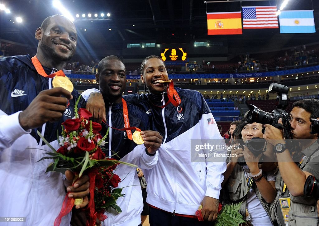 (HR) ABOVE: Carmelo Anthony, right, bites down on his medal with teammates Dwyane Wade, middle and Lebron James, left. The U.S. men's basketball team won the gold medal at the Beijing 2008 Olympic Games with a 118-107 victory over Spain Sunday afternoon a : News Photo