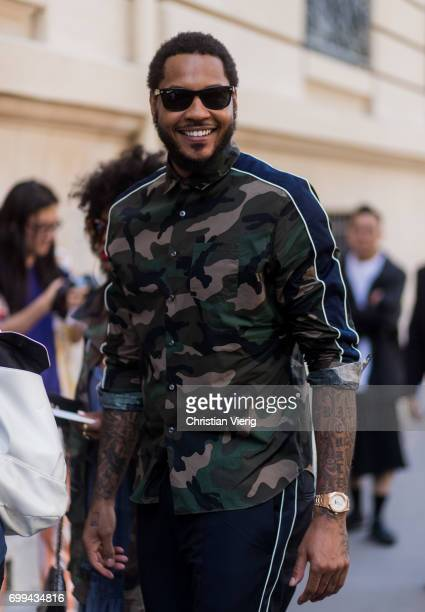 Carmelo Anthony wearing a camouflage jacket outside Valentino during Paris Fashion Week Menswear Spring/Summer 2018 on June 21 2017 in Paris France