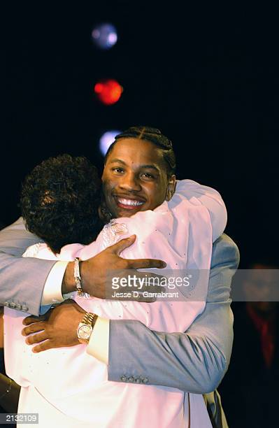 Carmelo Anthony who was selected by the Denver Nuggets hugs his mother Mary during the 2003 NBA Draft at the Paramount Theatre at Madison Square...