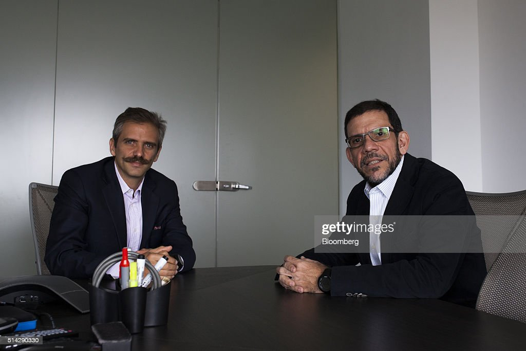Carmelo Haddad, left, and Francisco Ghersi, managing directors of Knossos Asset Management, sit for a photographer after an interview in the company's offices in Caracas, Venezuela, on Wednesday, March 2, 2016. When Haddad and Ghersi invested half their hedge fund's money into a soon-to-mature Venezuela bond in mid-January, only two outcomes were possible: the trade could go horribly wrong or it could pay off fabulously. Knossos Asset Management went on to make a return of 12 percent in just 45 days -- or an excess of 150 percent on an annualized basis. Photographer: Wilfredo Riera/Bloomberg via Getty Images