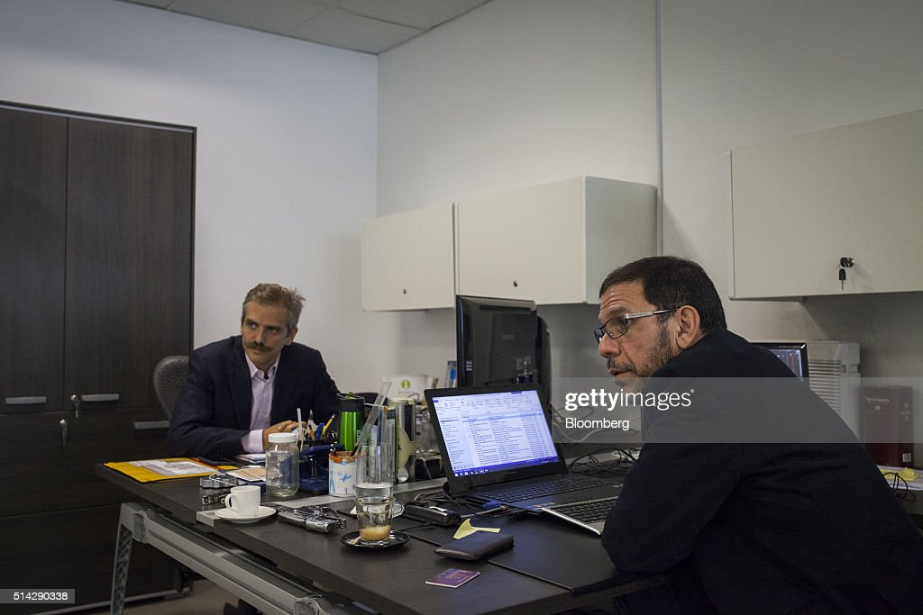 Carmelo Haddad, left, and Francisco Ghersi, managing directors of Knossos Asset Management, listen during an nterview in the company's offices in Caracas, Venezuela, on Wednesday, March 2, 2016. When Haddad and Ghersi invested half their hedge fund's money into a soon-to-mature Venezuela bond in mid-January, only two outcomes were possible: the trade could go horribly wrong or it could pay off fabulously. Knossos Asset Management went on to make a return of 12 percent in just 45 days -- or an excess of 150 percent on an annualized basis. Photographer: Wilfredo Riera/Bloomberg via Getty Images