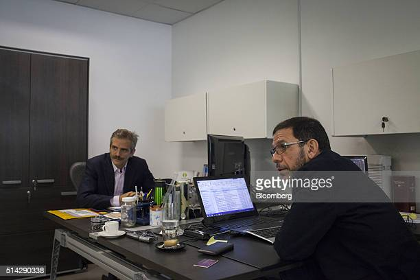 Carmelo Haddad left and Francisco Ghersi managing directors of Knossos Asset Management listen during an nterview in the company's offices in Caracas...