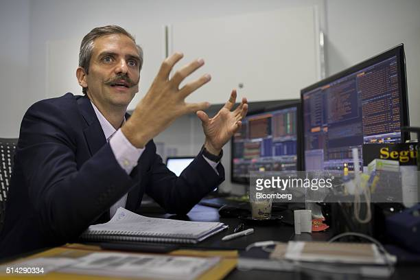 Carmelo Haddad managing director of Knossos Asset Management speaks during an interview in the company's offices in Caracas Venezuela on Wednesday...