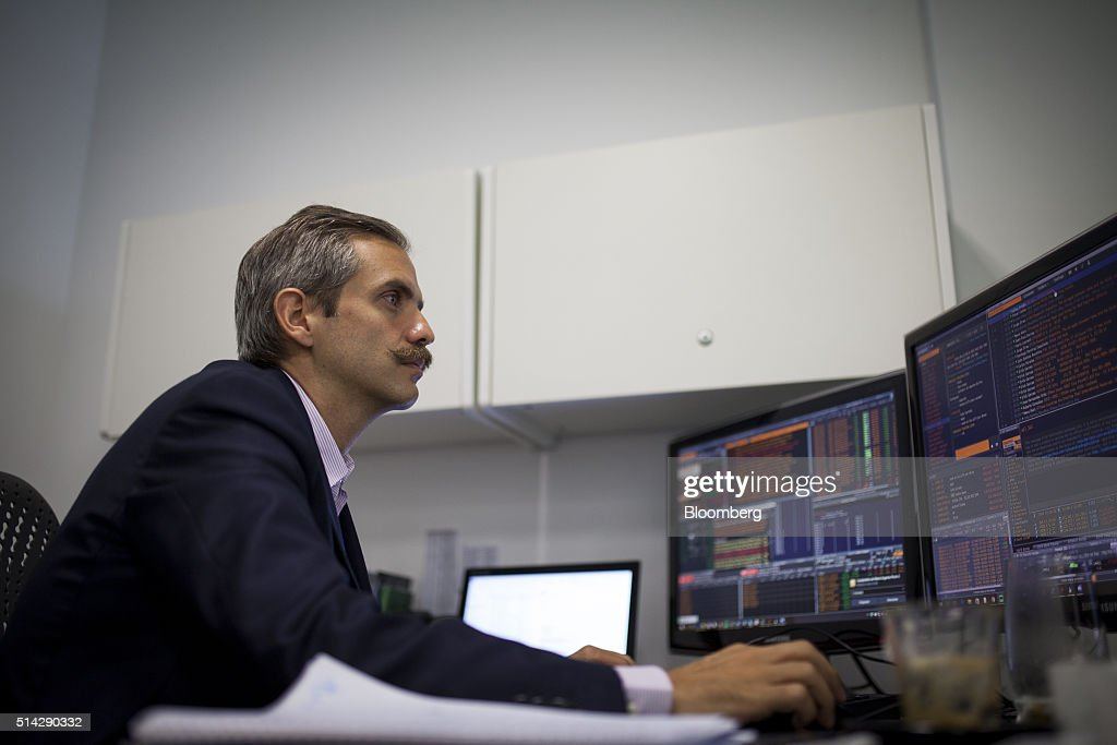 Carmelo Haddad, managing director of Knossos Asset Management, views a computer screen during an interview in the company's offices in Caracas, Venezuela, on Wednesday, March 2, 2016. When Haddad and fellow managing director Francisco Ghersi invested half their hedge fund's money into a soon-to-mature Venezuela bond in mid-January, only two outcomes were possible: the trade could go horribly wrong or it could pay off fabulously. Knossos Asset Management went on to make a return of 12 percent in just 45 days -- or an excess of 150 percent on an annualized basis. Photographer: Wilfredo Riera/Bloomberg via Getty Images