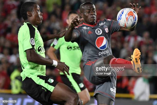 Carmelo Valencia of America de Cali fights for the ball with Ezequiel Palomeque of Deportivo Cali during the match between America de Cali and...