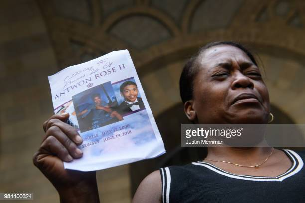 Carmen Ashley the great aunt of Antwon Rose II cries as she holds the memorial card from Rose's funeral during a protest calling for justice for the...