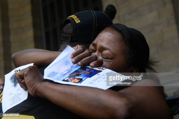 Carmen Ashley the great aunt of Antwon Rose II is embraced during a protest a day after the funeral for Rose on June 26 2018 in downtown Pittsburgh...