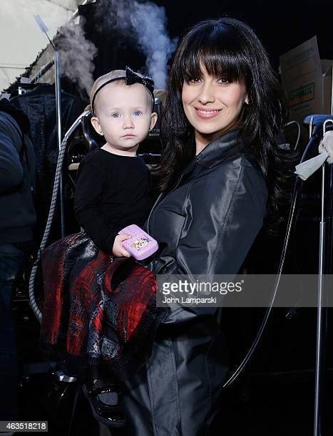 Carmen Baldwin and Hilaria Thomas Baldwin attend Carmen Marc Valvo during Mercedes-Benz Fashion Week Fall 2015> at The Theatre at Lincoln Center on...