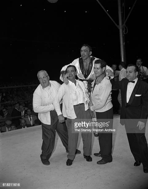 Carmen Basilio celebrates in the ring after his win for the middleweight title against Sugar Ray Robinson at Yankee Stadium Bronx New York September...