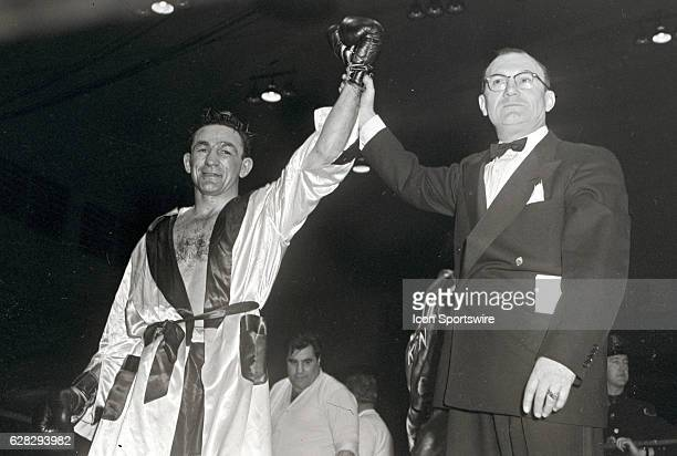 Carmen Basilio having his hand raised in victory by unknown ring announcer