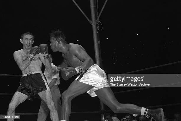 Carmen Basilio in a defensive stance as Sugar Ray Robinson throws a right Carmen Basilio would go on to win the middleweight title in the 15 round...