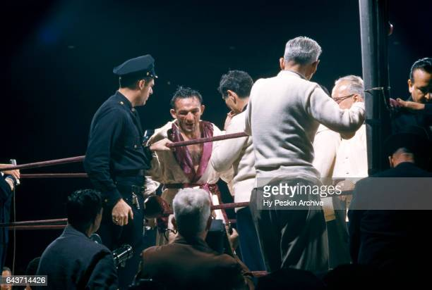 Carmen Basilio of the United States returns to his corner after being introduced before his match against Sugar Ray Robinson for the 1957 World...