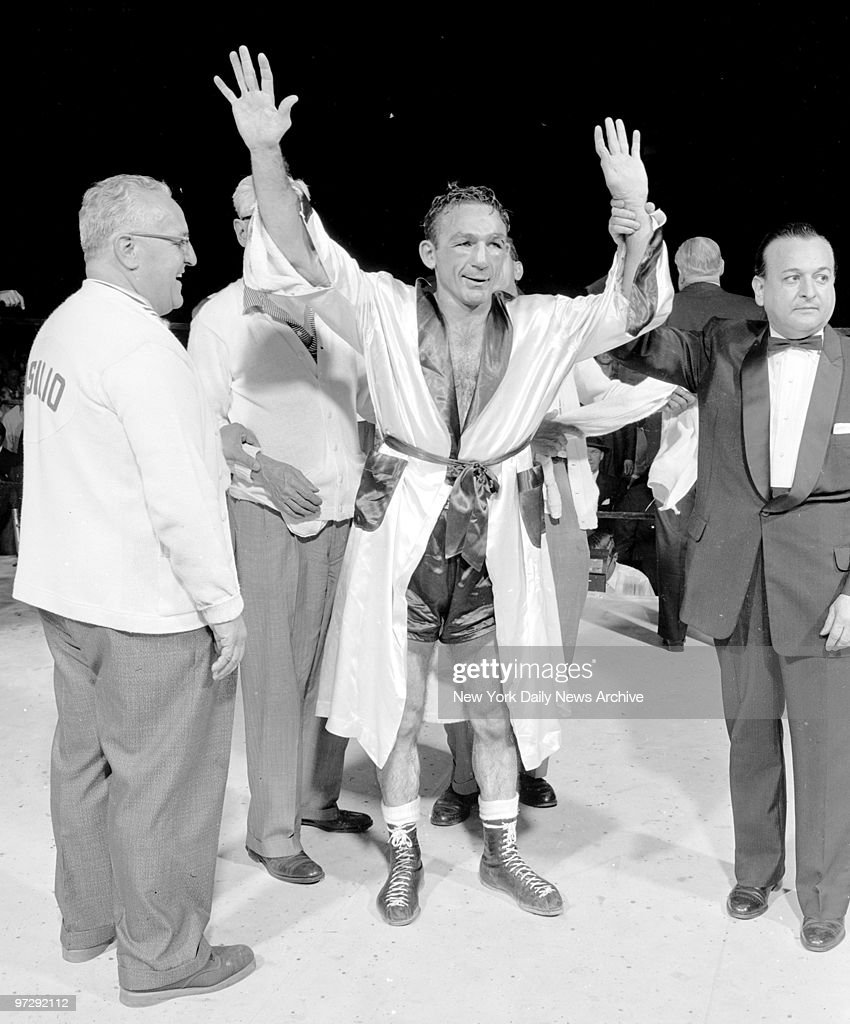 Carmen Basilio raises his hands in victory after winning a 1 : News Photo