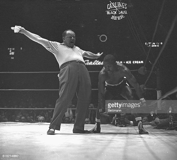 Carmen BasilioJohnny Saxton fight The Kayo Referee gives the signal that it's all over