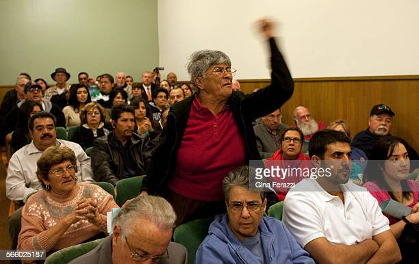 Carmen Bella a Bell resident for 33 years, yells in anger at Bell city leaders after a scheduled council meeting was cancelled due to lack of a...