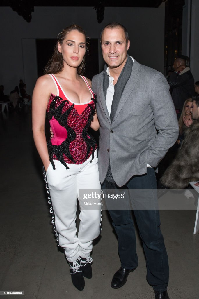 Carmen Carrera and Nigel Barker attend The Blonds fashion show during New York Fashion Week: The Shows at Spring Studios on February 13, 2018 in New York City.
