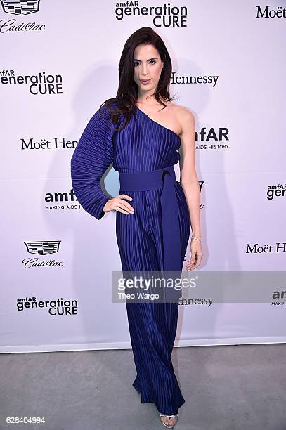 Carmen Carrera attends the 2016 amfAR GenerationCure Holiday Party at Cadillac House on December 7 2016 in New York City