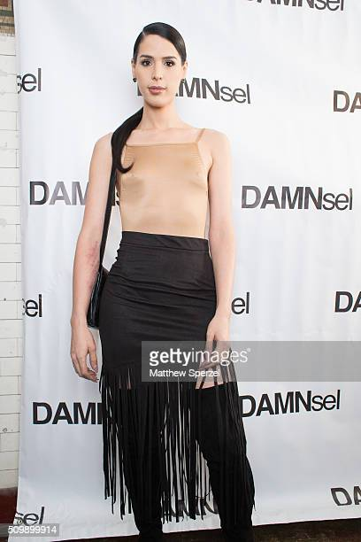 Carmen Carrera wearing Parsuco Suart Weitzman boots and Tom Ford handbag attends the Damnsel 'Garmeoplasty' presentation during Fall 2016 New York...