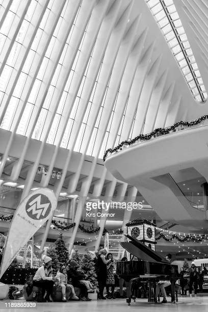 Image has been converted to black white Carmen Ching performs during Piano City as part of Make Music Winter at the Oculus on December 21 2019 in New...