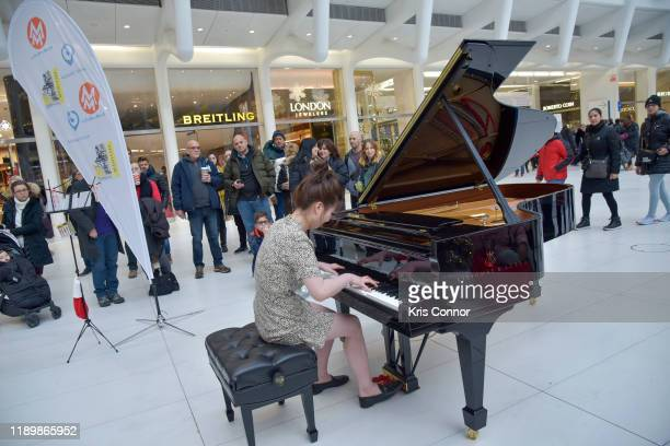 Carmen Ching performs during Piano City as part of Make Music Winter at the Oculus on December 21 2019 in New York City