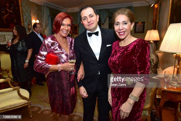 Carmen D'Alessio Rodrigo Nieto and Gilda Sacasa attend Martin and Jean Shafiroff Host Holiday Cocktails in Honor of the Victims of the California...